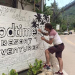 painting goodtime hostel sign