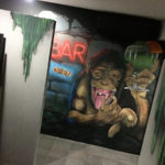 hostel drinking monkey mural