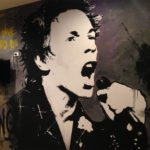 Johnny Rotten punk hostel wall mural